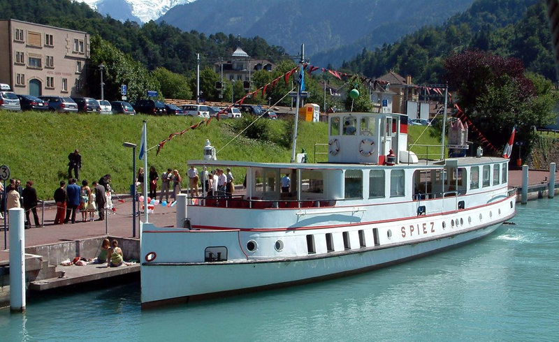 The classic Lake Thun motor vessel Spiez, berthed astern of Blumlisalp at Interlaken to embark a wedding party for a special sailing on the lake.