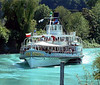 Paddle steamer Blumlisalp steaming up the Interlaken Ship Canal to Interlaken West.