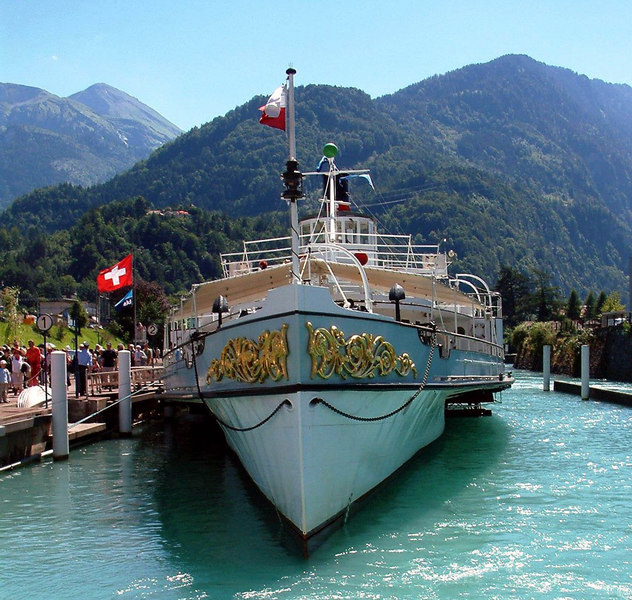 Paddle steamer Blumlisalp's two elaborate bow decorations. On close inspection the top of her bow rudder can also be seen. She uses it to go astern down the canal from Interlaken to Lake Thun and also to approach the berth on the River in her base at Thun