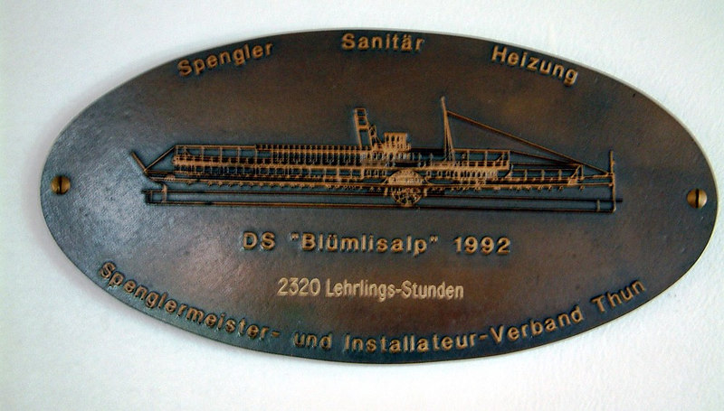A plate commemorating DS (Dampfshiff i.e. Steamship) Blumlisalp's return to service in 1992 aftermany years of idleness.