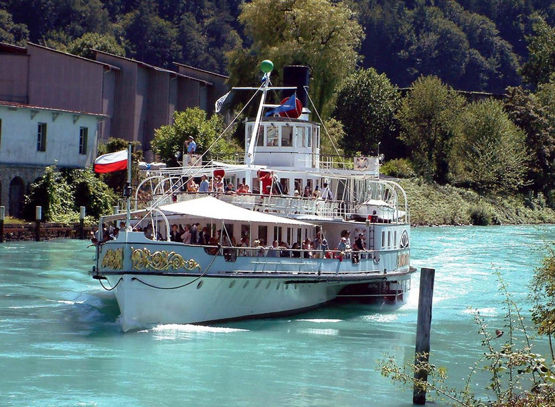 Paddle steamer Blumlisalp steaming up the Interlaken Ship Canal to Interlaken West.