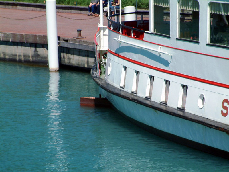 View showing the single-screw motor vessel Spiez's bow rudder set almost hard-a-port to assist her canting in the canal basin on departure from Interlaken