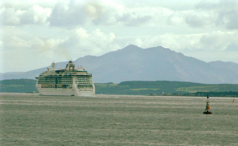 Jewel of the Seas passing down the Firth of Clyde with the peaks of the Island of Arran in the background.