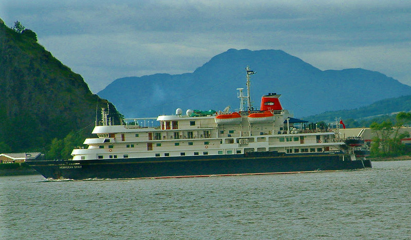 Hebridean Spirit heading down the River Clyde with the mountain Ben Lomond in the distance.
