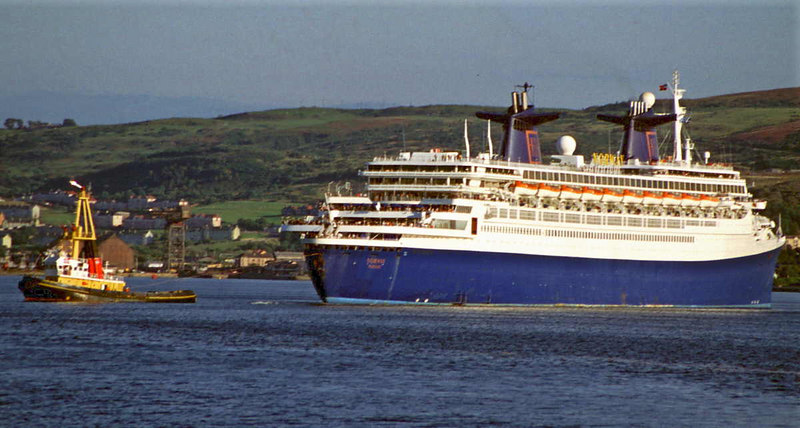 Clyde Shipping tug Flying Phantom assisting SS Norway off the berth at Greenock Ocean Terminal