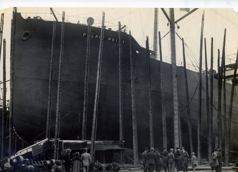 """ss PULPIT POINT<br /> Yard No 792<br /> Triple expansion steam engine by David Rowan & Co Ltd, Glasgow<br /> Launched: Friday, 27/08/1926, she was sister vessel of SS Plume for the Vacuum Oil Company, London (launched 2 months earlier).<br /> <br /> This view is from the launch day with guests assembling prior to the event. The rudimentary staging and light derrick cranes available to shipbuilders in the 1920s is obvious from these views.<br /> <br /> Career: <br /> <a href=""""http://www.clydesite.co.uk/clydebuilt/viewship.asp?id=18117"""">http://www.clydesite.co.uk/clydebuilt/viewship.asp?id=18117</a>"""