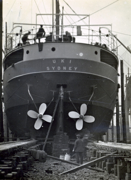 "ss UKI<br /> Yard No 753<br /> Launched: Wednesday, 21/03/1923 for the North Coast Steam Navigation Company, Sydney NSW<br /> Seen here from astern not long before launch with her twin propellers fitted. The propellers look to be painted so may be made from cast iron. Propellers of that type were manufactured by the firm of Andrew Strang at the Blair Foundry in Hurlford, Ayrshire. Larger and more expensive ships were fitted with propellers manufactured from bronze alloys. The principal supplier of such propellers on Clydeside was Bull's Metal & Melloid Co's Yoker foundry in Glasgow.<br /> <br /> Work is also progressing on preparing the launch 'ways'.<br /> Career: <a href=""http://www.clydesite.co.uk/clydebuilt/viewship.asp?id=18077"">http://www.clydesite.co.uk/clydebuilt/viewship.asp?id=18077</a>"