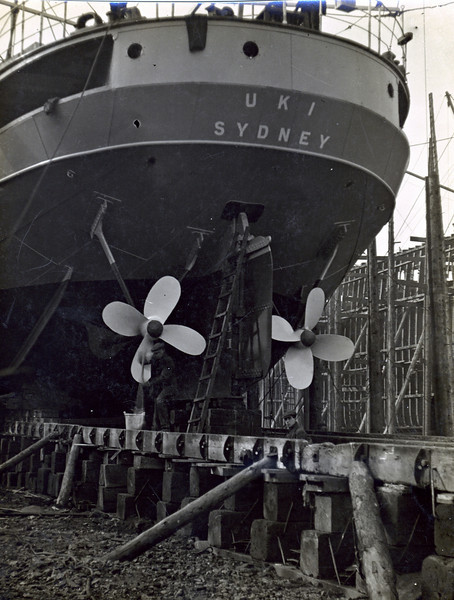 ss UKI<br /> Yard No 753<br /> Launched: Wednesday, 21/03/1923 for the North Coast Steam Navigation Company, Sydney NSW<br /> Seen here from astern not long before launch with her twin propellers fitted. Her rudder can be seen in position between the two propellers - the presence of the typical shipyard ladder suggests that some work is still ongoing on the rudder - possibly on the rudder stock gland.