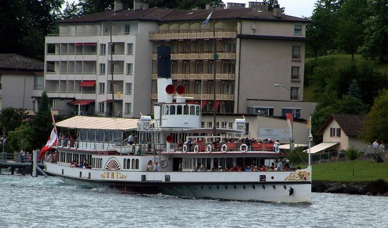 Paddle steamer Uri (from motor vessel Europa) departing from Hertenstein