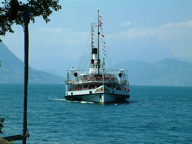 Paddle steamer Stadt Luzern, dressed overall for Swiss National Day August 1st (2003) approaching Treib from Gersau