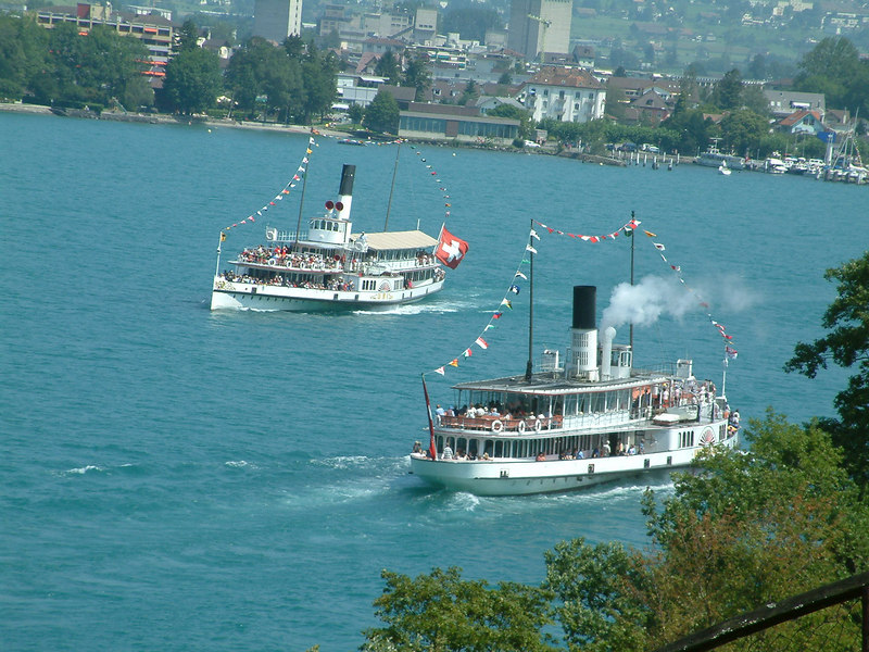Paddle steamer Unterwalden saluting paddle steamer Uri as they pass on the Vierwaldstattersee (Lake Lucerne) between Treib and Brunnen