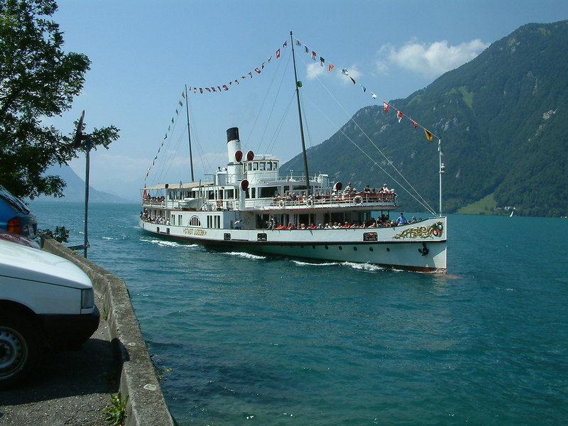 Paddle steamer Stadt Luzern, dressed overall for Swiss National Day August 1st (2003) arriving at Treib