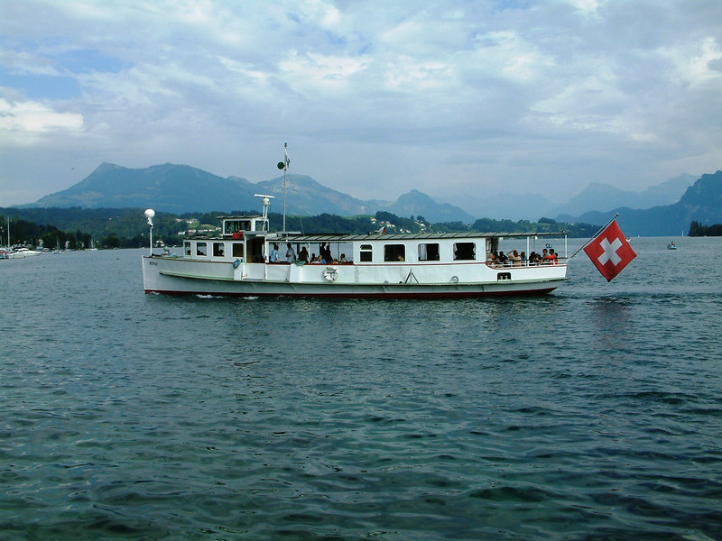 The veteran motor vessel Rutli crossing Luzern harbour from Pier 4 to Schweizerhofquai