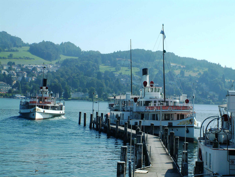 Paddle steamer Unterwalden leaving SGV Shipyard, Luzern with paddle steamer Stadt Luzern at the overnight berths