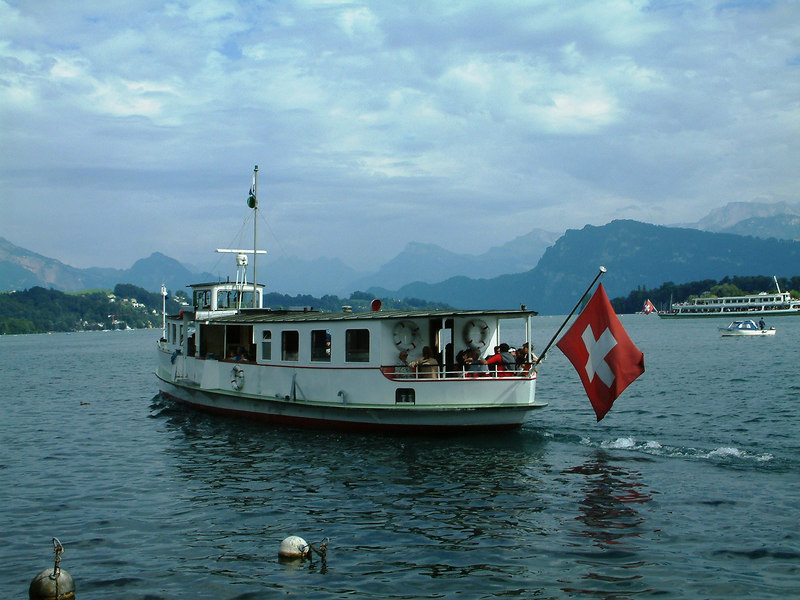 The veteran motor vessel Rutli crossing Luzern harbour from Pier 4 to Schweizerhofquai