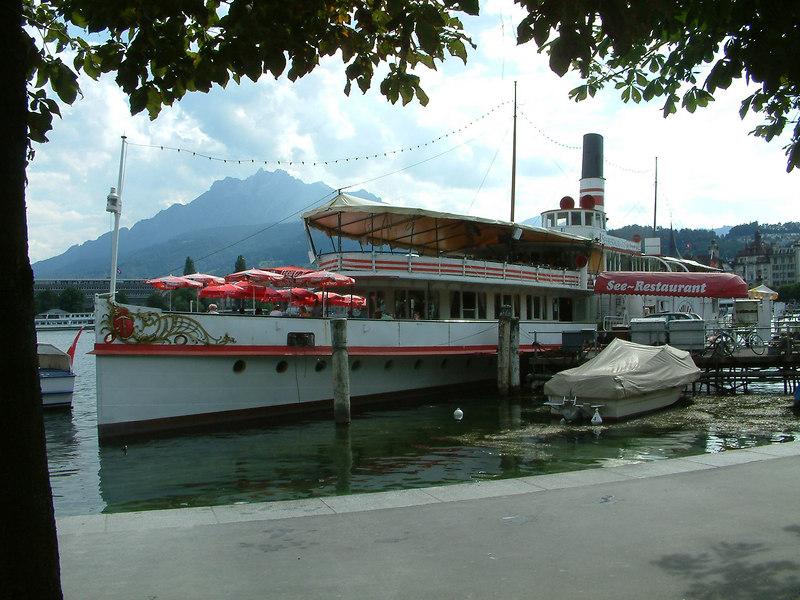 Paddle steamer Wilhelm Tell, a static restaurant / bar ship at Schweizerhofquai, Luzern<br /> Mount Pilatus in the background