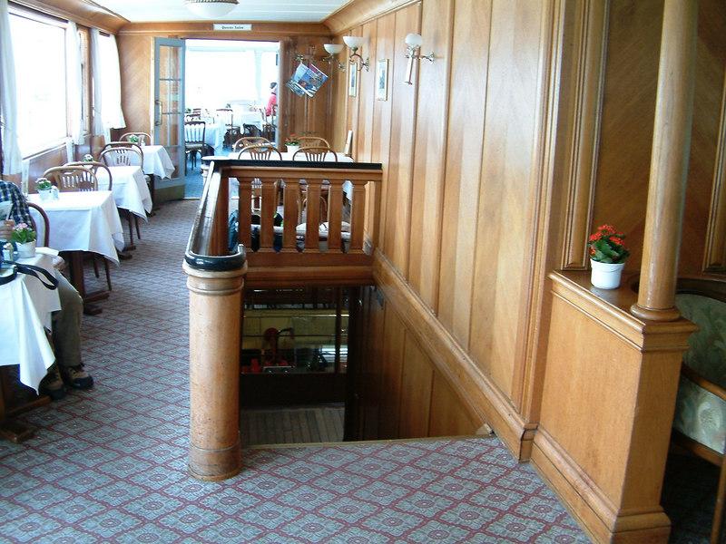 Upper deck lounge, Queen's Restaurant and main deck companionway of paddle steamer Stadt Luzern