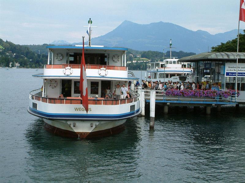 Motor vessel Weggis at Luzern Pier 1 woth Mount Rigi beyond in the distance