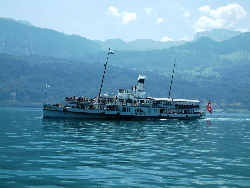 Paddle steamer Stadt Luzern saluting paddle steamer Uri with a blast from her steam whistle