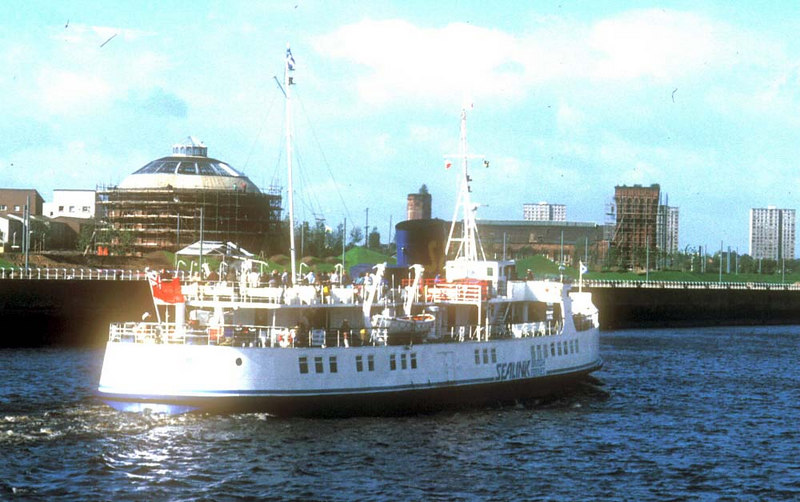 Southsea heading down the Clyde, passing the South Rotunda of the old Glasgow Harbour Tunnel on Mavisbank Quay, which was being renovated for a role in the 1988 Glasgow Garden Festival. Ahead of the vessel is the 'Four Winds' Building of the former Princes Dock Hydraulic Pumping Station which became a tramcar depot and pub during the Garden Festival.