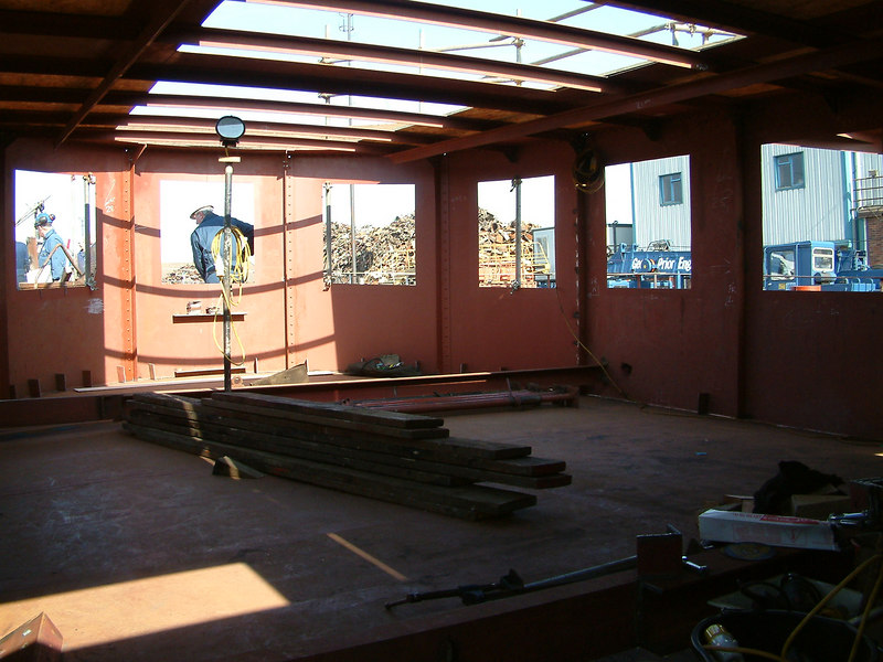 Inside the new forward deck shelter during reconstruction looking forward