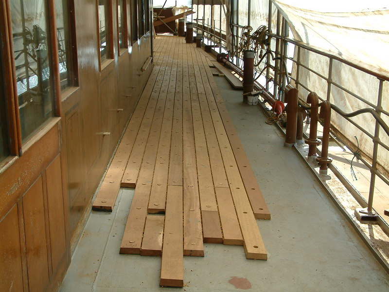 Laying of new deck timbers on port side of the promenade deck