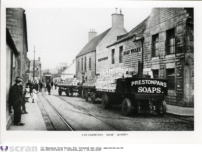 """In 1903, Alley & MacLellan took over the Shropshire company, Simpson & Bibby, who made steam lorries, and moved the business to Polmadie. After two years development work under Alley & MacLellan's Chief Draughtsman, Mr J  Haythorne, the Sentinel Steam Wagon was launched. The Sentinel brand already had a good reputation, and the new lorry was a great success. <br /> <br /> Picture shows an early Sentinel steam wagon supplied to the Prestonpans Soap Works<br /> <br /> ©Scottish Motor Museum Trust. Licensor  <a href=""""http://www.scran.ac.uk"""">http://www.scran.ac.uk</a>."""