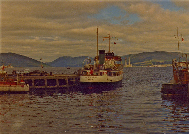 Queen of Scots berthed on the east end of Rothesay pier with one of the huge concrete platform jackets under construction at Ardyne in the distance.