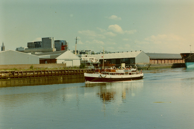 Queen of Scots passing Pointhouse with the Union Steamship Company of New Zealand's passenger vehicle ferry Rangitira in Yorkhill Basin and the tanker Matco Thames at Yorkhill Quay