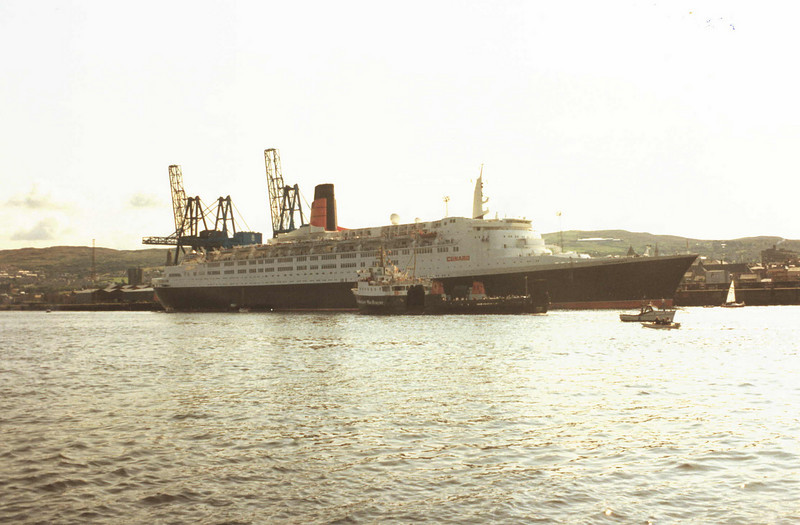 QE2's second visit to Greenock  - with Saturn cruising slowly alongside<br /> <br /> Picture by Tom Dunlop