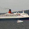 Small craft assembling to escort the liner down the Firth of Clyde<br /> <br /> Picture by Stuart Cameron
