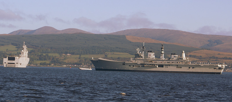 As Balmoral headed down the Firth of Clyde to meet the Cunarder she passed HMS Ark Royal and the French naval vessel T      which were anchored at the Tails of the Bank after taking part in a multi -national exercise of the West coast of Scotland