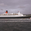 Two world famous Clyde icons.<br /> <br /> QE2 approaches the Cloch Lighthouse (built 1796)<br /> <br /> Picture by Stuart Cameron