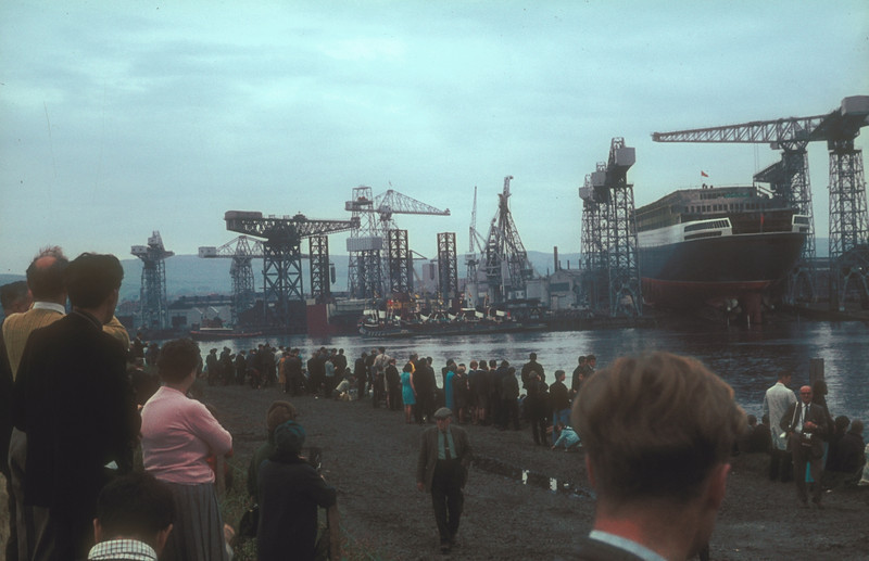 The crowds gather. As the S&B tugs wait to take charge of the new liner 3 Clyde Shipping Company tugs begin to remove Gulftide from the fitting out basin to make it easier to maneouvre the new liner into her fitting out berth.<br /> <br /> Picture by the late Mr William Davies