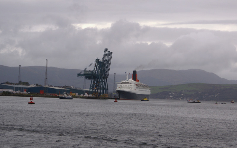 """FORTY YEARS AFTER HER LAUNCH- 20th September 2007<br /> <br /> After a day long series of celebrations, including a special 40th Anniversary salute by the famous Red Arrows, QE2 was preparing to depart from Greenock Ocean Terminal as motor vessel Balmoral approached on her special escort sailing from Glasgow. A host of small vessels had assembled to form an impromptu escort for the illustrious Clyde-built liner.<br /> <br /> Picture by Stuart Cameron<br /> <br /> For pictures of QE2's arrival and events earlier in the day see John Crae's superb album at<br /> <br />  <a href=""""http://jcrae.smugmug.com/gallery/3526016#199279749"""">http://jcrae.smugmug.com/gallery/3526016#199279749</a>"""