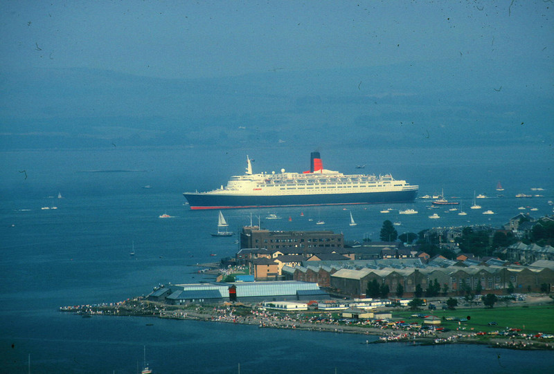 QE2 rounding Whiteforeland Point on her way out of the Clyde after her first return visit. <br /> <br /> At the time Cunard had stated that it was inlikely that the ship woul ever return to the Clyde.In fact she returned another 4 or 5 times before her retiral in 2008.