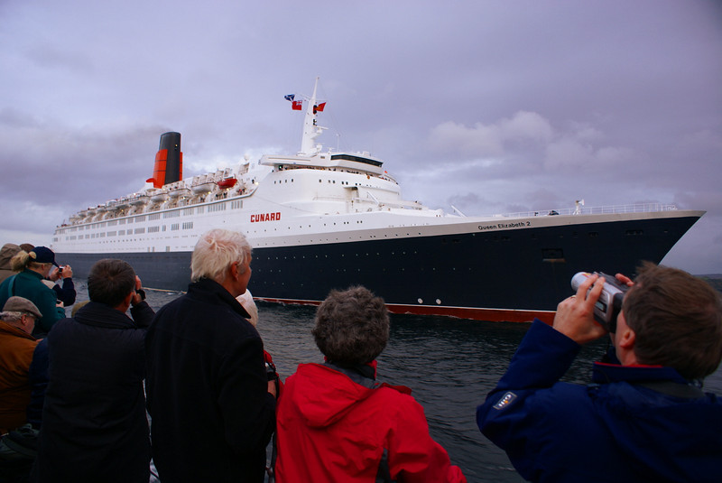 Captain Andy O'Brien of Balmoral gave his passengers a grand view of the large ship's beautiful lines. Thanks also to the Clyde Pilot aboard QE2, Capt Ian Jamieson, and the QE2's own master, Capt Ian McNaught, for agreeing to Balmoral coming in for a close look at the liner.<br /> <br /> <br /> Picture by Stuart Cameron