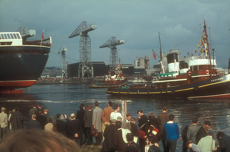 S&B tugs Campaigner, Strongbow and Cruiser start to pull the stern of the massive liner out of the River Cart to point upriver in the River Clyde. It is the confluence of the Rivers Clyde and Cart that made it possible to launch such large vessels from the Clydebank shipyard<br /> <br /> Picture by the late Mr William Davies