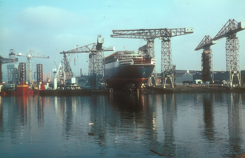 A day or so before the launch, John Brown Yard No 736 on the ways - with the drilling rig Gulftide in the fitting out basin.<br /> <br /> Picture by the late Mr William Davies