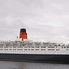 QE2 at Greenock Ocean Terminal. The liner had visited this berth on 3 other occasions since 1990. However, the 2007 visit was the only occasion on which the ship berthed 'starboard side to' the quay with her bows pointing upriver towards Clydebank where she had been launched 40 years earlier.<br /> <br /> Picture by Stuart Cameron