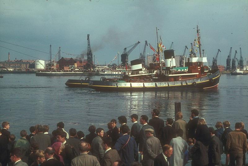 Steamers and tugs were dressed with colourful signal flags for the occasion. The Clyde Port Authority's tug / tender Clyde can be seen in the river ahead of Cruiser.<br /> <br /> Picture by the late Mr William Davies