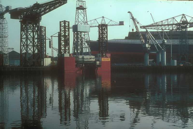 Gulftide in the Basin, the 1907 Arrol Titan and the 1 year older Cowans Sheldon heavy crane with No 736 beyond<br /> <br /> Picture by the late Mr William Davies