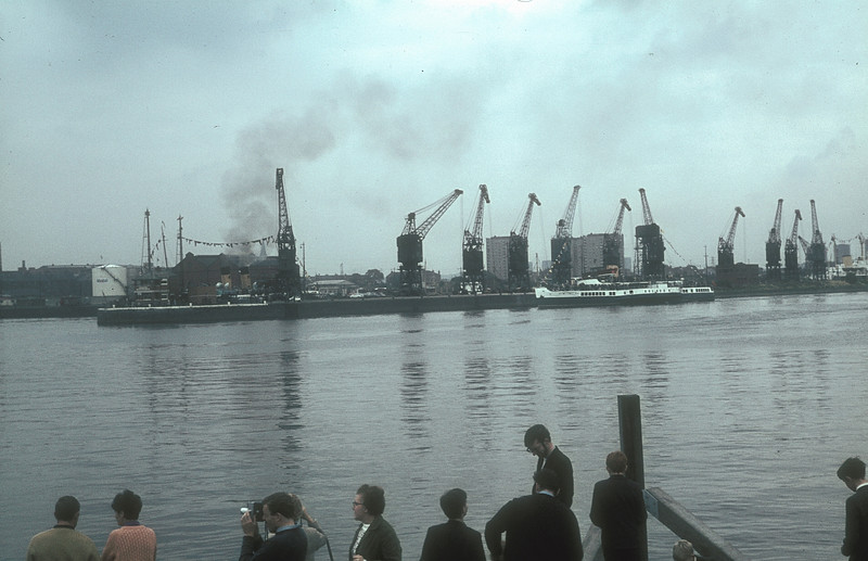 With the Duchess of Hamilton berthed in the Rothesay Dock the Clyde paddle steamer Caledonia arrives from Glasgow with another party to witness the launch<br /> <br /> Picture by the late Mr William Davies