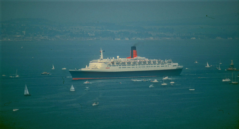 QE2 departing from the Clyde in 1990 - viewed from Tower Hill, Gourock<br /> <br /> Picture by Stuart Cameron
