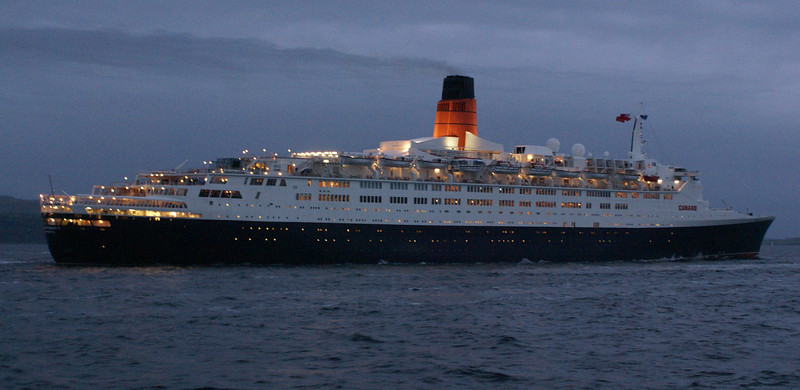 QE2 was now gathering speed and leaving most of her escorts behind although many of them seemed reluctant to turn for home and waited to see the great liner sail off into the darkness.<br /> <br /> Picture by Stuart Cameron