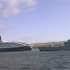 RMS Queen Elizabeth 2 and HMS Manchester passing Innellan