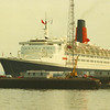 After the new liner left the Clyde in 1969 it was over 20 years until she returned to the river of her birth. Although the Cunard Line had most of its ships built on the Clyde the river did not feature in the Company's main transatlantic services which ran from Liverpool (later Southampton) to New York. However, the Company's services from Liverpool to Canada had called at Greenock until their demise in the mid 1960s. The final liners on that service was the Clydebank-built 'Sylvania' quartette , products of the John Brown yard in the 1950s<br /> <br /> Traditionally, the Cunarders had anchored off Greenock at the Tail of the Bank, their passengers joining and leaving by the Clyde steamers, acting as tenders. <br /> <br /> Picture by Stuart Cameron