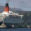 After her call of 2007 when, uniquely, QE2 berthed 'starboard side to' at Greenock Ocean Terminal, she returned to the practice of all previous visits and berthed 'port side to' for her final call. This required the vessel to cant through almost 180 degrees at the famous Clyde anchorage, the Tail of the Bank. In carrying out this manoeuvre she was assisted by three tugs owned by Switzer and one by Clyde Marine. The Switzer Clyde fleet is the descendant of Cory (Clyde) which, in turn, was originally the Greenock-based tugmasters  Steel & Bennie. Therefore, this view is very fitting as it provides a direct connection to pictures shown earlier in this gallery when, at her launch,  7 tugs of the Steel & Bennie fleet became the first of many hundred of tugs around the globe that have assisted the great liner at the start and finish of her 800+ transatlantic crossings and at many world ports in her ubiquitous winter wanderings.