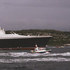 The massive ship and the Cloch lighthouse<br /> <br /> Picture by Stuart Cameron