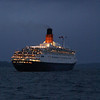 Before Balmoral turned to make her way back to Glasgow her passengers offered up three cheers for the great liner and Balmoral sounded a three blast salute on her horn, This was reciprocated by a simlar - though louder - reply by the departing Queen.<br /> <br /> Ahead of the ship in this view are the Cumbrae Islands on which can be seen the solitary light of the Cumbrae Elbow Lighthouse. It is off that light that the Clyde Pilot left the liner.<br /> <br /> Au revoir, Great Queen!<br /> <br /> Picture by Stuart Cameron